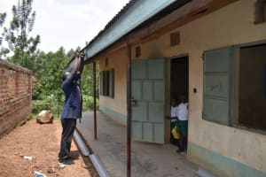 The Water Project: Kitambazi Primary School -  Affixing Gutters