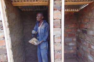 The Water Project: Kitambazi Primary School -  Plastering Interior Latrine Walls