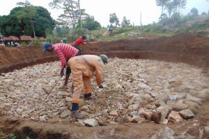 The Water Project: Kitambazi Primary School -  Breaking Down The Rocks To Create Level Surface