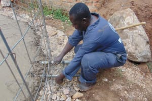The Water Project: Kitambazi Primary School -  Placing The Drawing Point Pipes