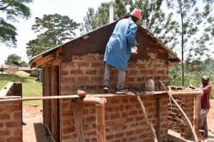 The Water Project: Friends Musiri Primary School -  Plastering The Latrines