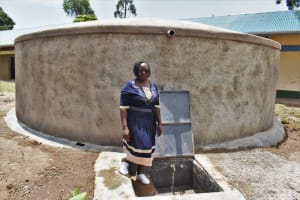 The Water Project: Friends Musiri Primary School -  Madam Margaret At The Water Point