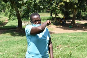 The Water Project: Emutetemo Community, Lubale Spring -  Trainer Jacky Shows The Elbow Cough And Sneeze