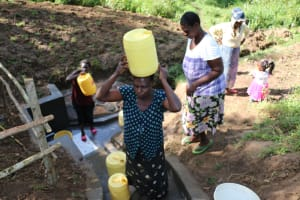 The Water Project: Emutetemo Community, Lubale Spring -  Carrying Water Up The Cement Steps
