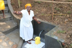 The Water Project: Emutetemo Community, Lubale Spring -  Fetching Water With Joy
