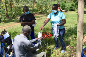 The Water Project: Emutetemo Community, Lubale Spring -  Providing New Masks To Training Participants