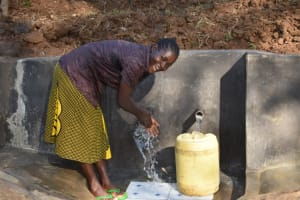 The Water Project: Mushikulu B Community, Olando Spring -  Everline Wahing Hands Before Fetching Water