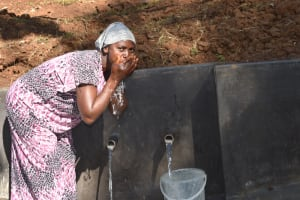 The Water Project: Mushikulu B Community, Olando Spring -  Fatuma Drinking Water From The Spring