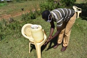 The Water Project: Mushikulu B Community, Olando Spring -  Ibrahim Chetambe Washing Hands