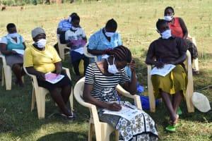 The Water Project: Mushikulu B Community, Olando Spring -  Listening And Taking Notes At Training