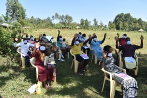 The Water Project: Mushikulu B Community, Olando Spring -  Participants Demonstrating How They Wave At Each Other