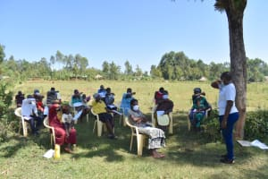 The Water Project: Mushikulu B Community, Olando Spring -  Participants Demonstrating How To Cough Using Bent Elbow