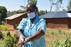 The Water Project: Mushikulu B Community, Olando Spring -  Peletina Oloyo Washing Hands Using Soap And Water
