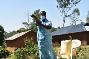 The Water Project: Mushikulu B Community, Olando Spring -  Peletina Oloyo Washing Hands Up To Elbows