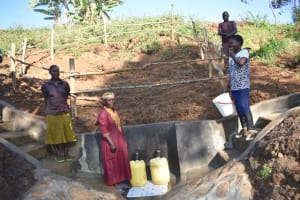 The Water Project: Mushikulu B Community, Olando Spring -  People Collecting Water