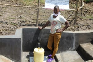 The Water Project: Mabanga Community, Ashuma Spring -  Isabella At The Completed Spring