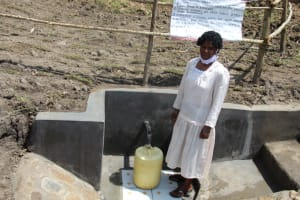 The Water Project: Mabanga Community, Ashuma Spring -  Selpha Nyakoa At The Completed Spring