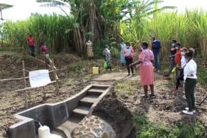 The Water Project: Mabanga Community, Ashuma Spring -  Trainer Emma Leads Site Management Session