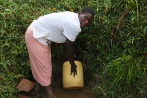 The Water Project: Khunyiri Community, Edward Spring -  Alice Shikhule Fetching Water