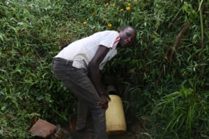 The Water Project: Khunyiri Community, Edward Spring -  Brian Collecting Water