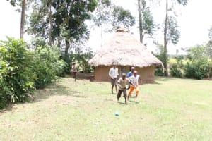 The Water Project: Khunyiri Community, Edward Spring -  Children Playing Football