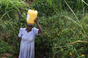 The Water Project: Khunyiri Community, Edward Spring -  Community Member Carrying Water