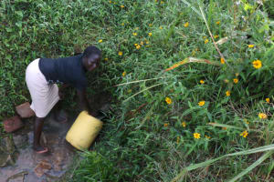 The Water Project: Khunyiri Community, Edward Spring -  Community Member Collecting Water