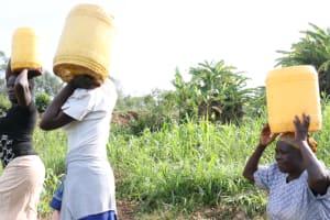 The Water Project: Khunyiri Community, Edward Spring -  Women Carrying Water