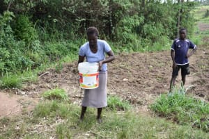 The Water Project: Emuyere Community, Kaikai Spring -  People Carrying Water