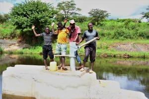 The Water Project: Mathanguni Community A -  Benson And Community Members At The Well