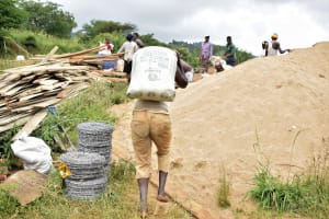 The Water Project: Mathanguni Community A -  Carrying Cement