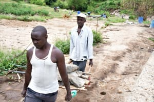 The Water Project: Mathanguni Community A -  Carrying Rocks