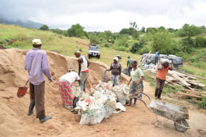 The Water Project: Mathanguni Community A -  Community Members Supporting Construction