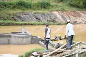 The Water Project: Mathanguni Community A -  Carrying Rocks To Finish Well Base