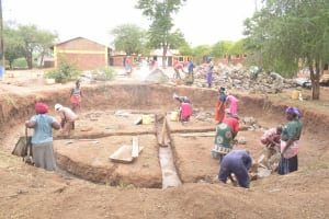 The Water Project: Kalatine Primary School -  Community Members Help Dig Out Tank Site