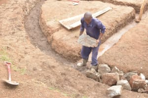 The Water Project: Kalatine Primary School -  Placing Large Rocks