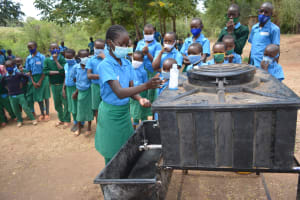 The Water Project: Kalatine Primary School -  Student Washes Her Hands