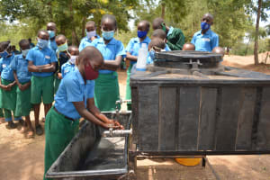 The Water Project: Kalatine Primary School -  Student Washes His Hands