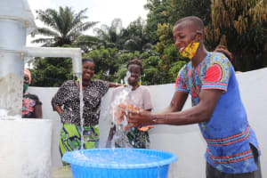 The Water Project: Lungi, Suctarr, #47 Kamara Street -  Boy Splashing At The Well