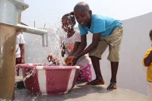 The Water Project: Lungi, Tintafor, Police Barracks E-Line Block 7 -  Children Splash At The Well