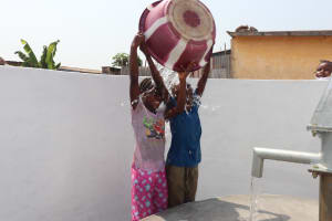 The Water Project: Lungi, Tintafor, Police Barracks E-Line Block 7 -  Kids Dump Clean Water In Celebration