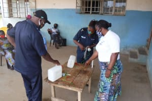 The Water Project: Lungi, Tintafor, Police Barracks E-Line Block 7 -  Participants Constructing Tippy Tap