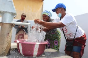 The Water Project: Lungi, Tintafor, Police Barracks E-Line Block 7 -  Splashing At The Well