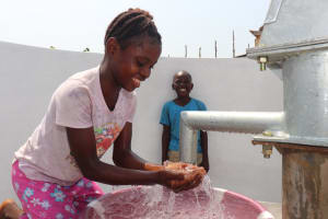 The Water Project: Lungi, Tintafor, Police Barracks E-Line Block 7 -  Young Girl Celebrates The Well