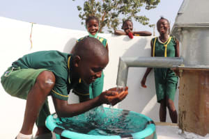 The Water Project: Lungi, Tintafor, Sierra Leone Church Primary School -  Boy Drinks From The Well