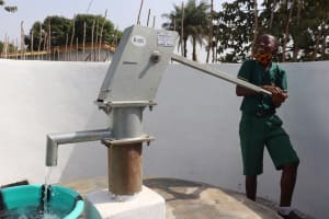 The Water Project: Lungi, Tintafor, Sierra Leone Church Primary School -  Pumping The Well
