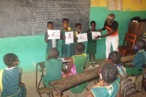 The Water Project: Lungi, Tintafor, Sierra Leone Church Primary School -  Students Display Hygiene Posters