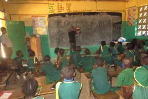 The Water Project: Lungi, Tintafor, Sierra Leone Church Primary School -  Students Listen During Training