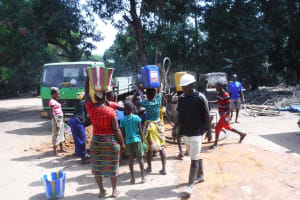 The Water Project: Lokomasama, Satamodia Village -  Community Members Fetching Water For Drilling