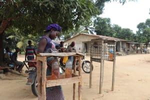 The Water Project: Kamasondo, Robay Village, Next to Mosque -  Girl Selling Petrol